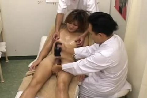 Two Sneaky Japanese Massage Parlor Workers Work On An nice-looking tranny!